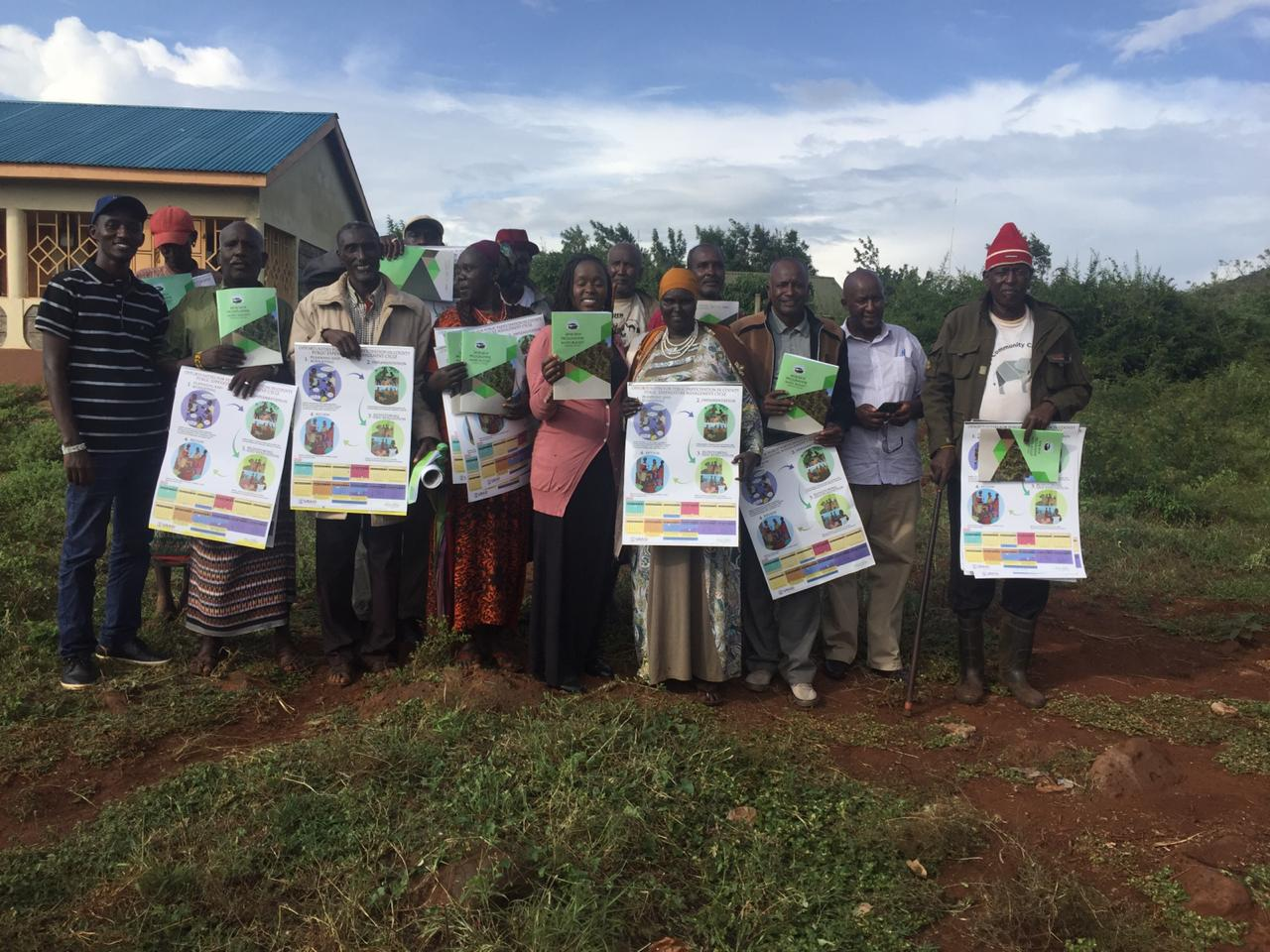 GAF team handing out PEM calendars and simplified budgets to residents of Marsabit county